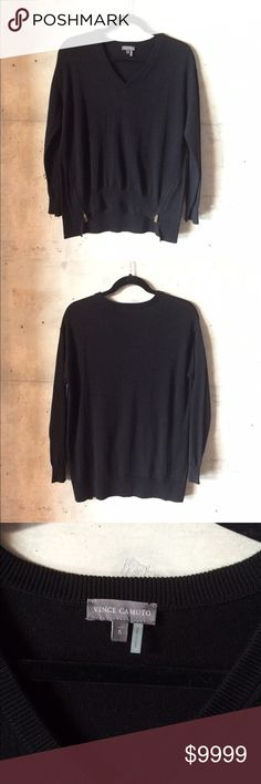 Vince Camuto black v neck oversized sweater Vince Camuto v neck oversized zipper detailed sweater   Condition: new with tags   Color: black   Measurements: Size small Underarm to underarm is approximately  20 1/2 inches across.  Length from back of neck to bottom of hem is approximately  27 1/2 inches, shorter in front with zipper design  Materials: 60% cotton, 40% acrylic Vince Camuto Sweaters V-Necks