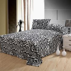 $24 Zebra Bed Sheets FOR ME: mainly idea for window dressing..recover a cushion or pillow...etc..