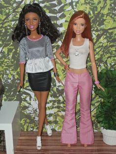 This sale is for TWO B arbie dolls and outfits! The African American Nikki doll is a classic with amazing hair and a cute stylish look including a handmade stretch black mini skirt! She comes with platform white lace up detailed open toe shoes and silver jewelry too!   eBay!