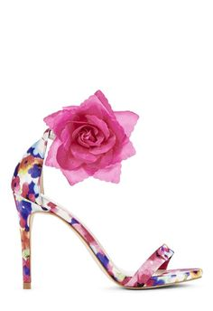 Two looks, one fabulous shoe! Kyla is a single-sole stiletto with a removable flower on the strap