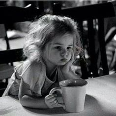 Little girl drinking coffee and having a rough day