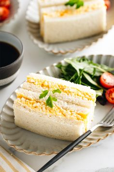Japanese Egg Sandwich (Tamago Sando) Egg salad tucked between slices of white bread, Tamago Sando or Japanese egg sandwich is a timeless grab-and-go snack you can find in every convenience store in Japan. The filling is creamy and bursting with a rich egg Easy Egg Recipes, Easy Japanese Recipes, Cooking Recipes, Healthy Recipes, Japanese Sweet Egg Recipe, Japanese Egg Salad Sandwich Recipe, Japanese Food, Japanese Gyoza, Korean Recipes