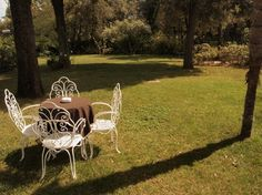 """Grand Hotel Rimini - Chairs and table on the front lawn"" by @Keane Li"