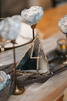 gemstone table number - photo by Karen Kristian Photography http://ruffledblog.com/smoke-and-mirrors-wedding-inspiration