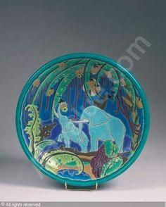 Grand plat circulaire à décor africain   3300 EUR Vente :Drouot Richelieu, Salle 15 Paris 07/12/2007