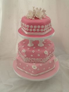 Pink and white sparkly hexagonal wedding cake