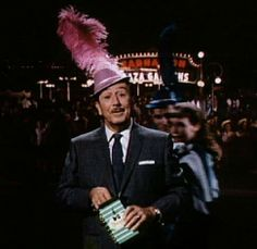 """You may be cool, but you'll  never be """"Walt Disney in a purple feathered hat"""" cool."""