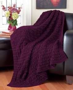 Knit this cabled afghan using Caron Simply Soft yarn.