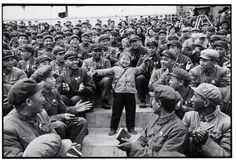 """Kang Wenjie, a five-year-old prodigy selected as champion of """"learning and applying Mao Zedong Thought,"""" dances the """"loyalty"""" dance for the representatives of the Provincial Conference of Learning and Applying Chairman Mao?s Works at Red Guard Square; Harbin, Heilongjiang Province, April 28, 1968     © LI Zhensheng   Contact Press Images"""