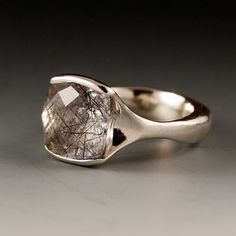 i love it!!!  it's the best engagement ring ever!  and all the rings from nodeform on etsy are AMAZING