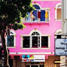 A female clothing shop in Montego Bay Jamaica right in the central square and next to the city museum about slavery - fucking rock 'n roll man #Jamaica #montegobay #clothing #female #power #sexy #pink #wallart #streetart