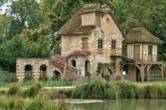 The Queen's Hamlet/ Hameau de la Reine in Yvelines, France. Built for Marie Antoinette, it consists of 11 cottages spread out around a lake.