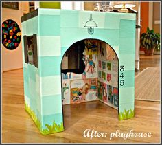 Cardboard PlayHouse - This budget friendly post will show you how to take a regular old box and make a very cute cardboard playhouse your kids will love.