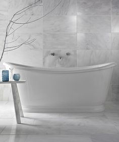 Marble look tiles on floor and wall, creating an illusion of depth to any small bathroom.