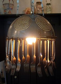 Kitchen Chandelier out of old colinder and silverware. # repurpose, home decor, handmade, art