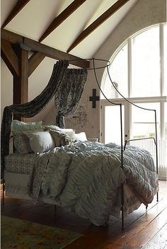 Different kind of canopy bed. Love the scrumptious bedding. Anthropologie.