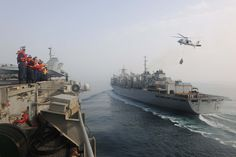 U.S. Sailors aboard the USS Theodore Roosevelt prepare to conduct an underway replenishment with the USNS Arctic in the Persian Gulf, July 15, 2015. The Theodore Roosevelt is deployed in the U.S. 5th Fleet area of responsibility supporting Operation Inherent Resolve and other security efforts in the region.