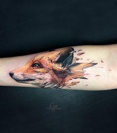 Vlad Tokmenin fox tattoo