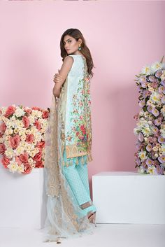 Shirt: Fabric: Embroidered Front, Printed Back with Sleeves Shalwar/Trousers: Fabric: Self Printed Trouser. Dupatta: Fabric: Embroidered Net Dupatta