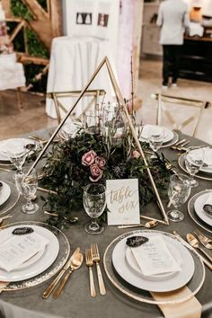 wedding decor Romantic + modern wedding reception table featuring geometric decor, pink blooms, and gold accents