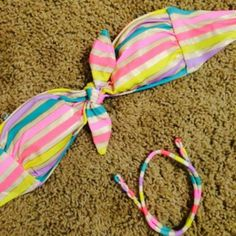 Victoria's Secret Stripe Tie Bandeau Swim Top Size XS. Worn maybe three times. Comes with halter string. Has padding. Victoria's Secret Tops