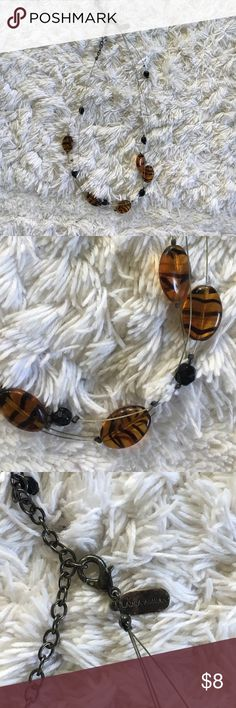 Brown tiger eye looking necklace, Laura Ashley Laura Ashley, tiger eye looking stone necklace, stones float on wire. Laura Ashley Jewelry Necklaces