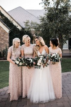 A champagne and ivory wedding color palette with beaded bridesmaids dresses and gorgeous eucalyptus, rose, and protea bouquets