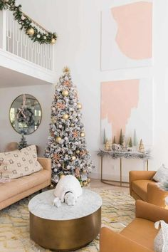 10 ft christmas tree and abstract pink decor in living room [art work / painted canvases & wreath over mirror] Front Door Christmas Decorations, Modern Christmas Decor, Beautiful Christmas Decorations, Christmas Living Rooms, Christmas Themes, Holiday Decor, Celebrating Christmas, Christmas Tree Inspiration, Colorful Christmas Tree