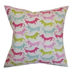 Cotton pillow with dachshund motif. Made in the USA.   Product: PillowConstruction Material: Cotton and down fill...