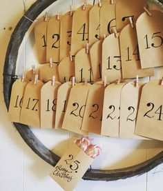 Rust Emporium~repurposed old sieve used as an advent calendar $35. Just pop a treat into each envelope!