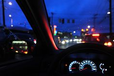 0 to 0 in forever, waiting at the stop light, waiting for Godot, car dashboard, lights, open window, lights, night, Seattle, Washington, USA