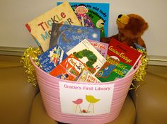 Baby shower idea - instead of a card ask guests to bring their favorite children's book signed for baby!