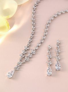 Add a touch of sparkle to your wedding day with this matching set by Jon Richard jewellery.