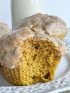 Pumpkin donut glazed muffins bake up perfectly and are so soft & fluffy. Full of pumpkin and pumpkin spices and then dipped in a delicious maple cinnamon glaze.