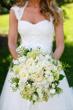 A classic bridal bouquet with white and green roses and hydrangeas | @allanzepeda | Brides.com