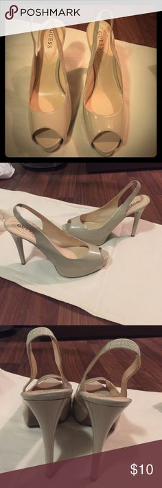 Guess size 11 nude peep toe high heels Guess size 11 nude peep toe high heels. Only worn a few times as they make nice shoes to wear to a wedding. Guess Shoes Heels