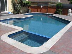 French Gray Plaster with Blue 3M and Natural Gray coping. (For reference - tiled spa/pool integration)