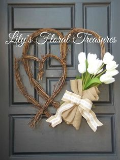 Double Heart Wreath made of Twigs, accented with Paper White Tulip wrapped in burlap.