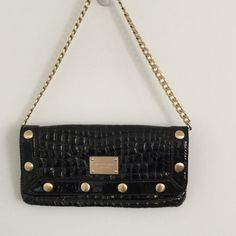 Michael Kors Delancey Black Patent Croc Clutch A rare find, most in style has the MK metallic fabric. This is an amazing crock pattern with a gold chain shoulder strap and brushed gold rivet details.  In like new condition with one small inner pocket. NO TRADE PLEASE. Michael Kors Bags Shoulder Bags