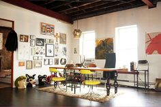 Erin Wasson's uber cool warehouse apartment. The table and chairs are so fab' vintage industrial.