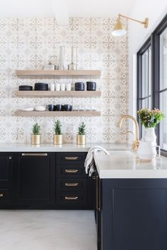 Modern Farmhouse Style Kitchen with black cabinets, modern gold fixtures and pul. Modern Farmhouse Style Kitchen with black cabinets, modern gold fixtures and pulls, decorative tile and rose accents. Farmhouse Style Kitchen, Modern Farmhouse Kitchens, Black Kitchens, Home Decor Kitchen, New Kitchen, Home Kitchens, Kitchen Ideas, Kitchen Inspiration, Kitchen Modern