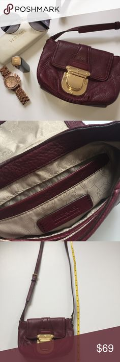 Michael Kors Purse Cross body Purple Plum Gold Sm This is in like new condition. I have taken it out for a few trips with just my lipgloss, cell phone, ID and credit card inside. No stains or wear inside. This was bought in Chicago.   Beautiful plum purple. Measurements in pictures. Can be worn over the shoulder or across the body. Perfect for throwing all your essentials into! Great for on the go and having your hands free! 😊💕 Michael Kors Bags Crossbody Bags