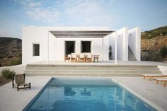 This house in the settlement of Kamari, on the island of Paros, was designed by React Architects by reinterpreting cubic Cycladic architecture with a modern and minimalist twist.