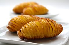 Hasselback Potatoes from Seasaltwithfood.  Sliced baked potatoes: thinly slice almost all the way through. drizzle with butter, olive oil, salt and pepper. bake at 425 for about 40 min