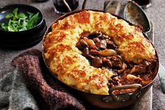 Slow-cooked lamb with cheesy potato crust