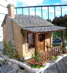 http://www.greenleafdollhouses.com/dollhouse_news/JUL2008/adams-doll-house.html