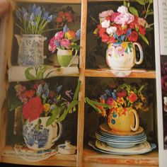 I love this look of mixed colored flowers in vintage vases and teapots