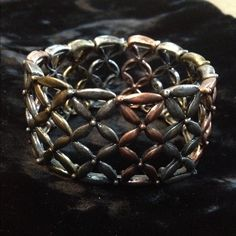 """Premier Designs """"Exotic"""" Stretch Cuff Bracelet ~ This easy-on and off stretch cuff bracelet by PREMIER DESIGNS has brushed copper, silver and gold tones. Worn once and in excellent preowned condition with no issues. Premier Designs Jewelry Bracelets"""