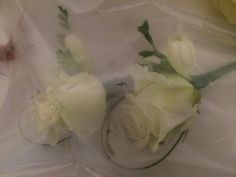 White avalanche rose corsages / buttonholes with white freesias for a gorgeous scent www.entirelybridal.co.uk www.facebook.com/entirelybridal