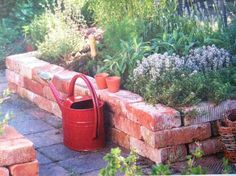 Great way to use leftover bricks / raised bed.